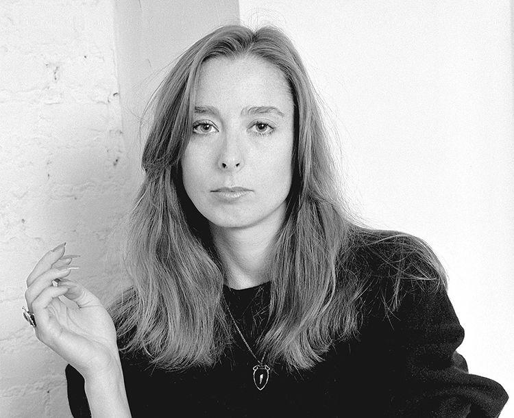 Ann Beattie in New York City apartment. 1980