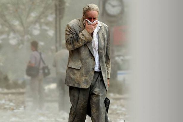edward-fine-covering-his-mouth-as-he-walks-through-the-debris-after-the-collapse-of-one-of-the-world-trade-center-towers-pic-afp-830362614